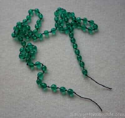 Add beads then dab the two end knots with glue