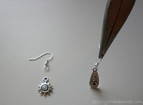 Hanging earrings featuring pendants