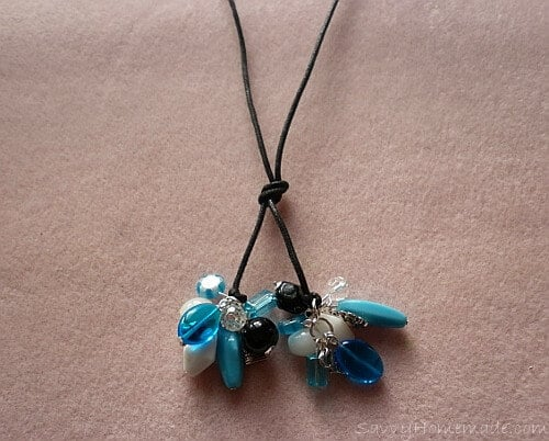 Tie a knot in the leather a few inches above the clusters to wear as a lariat style necklace.