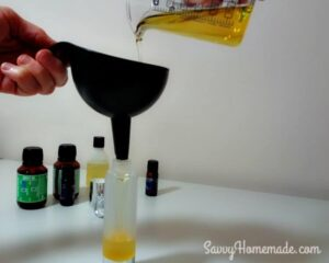 pouring natural oil in to bottle