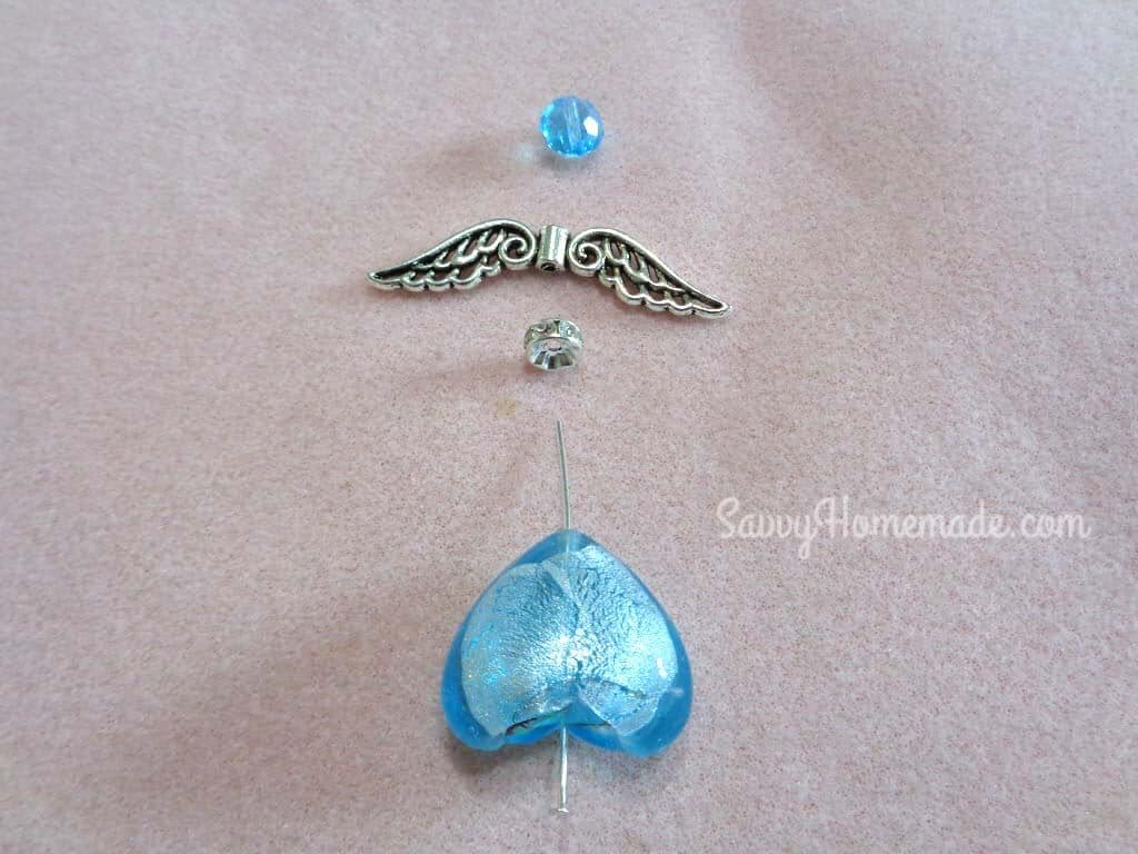 Thread the heart stone, Crystal Rondelle, Angel wings and Gem on to a head pin