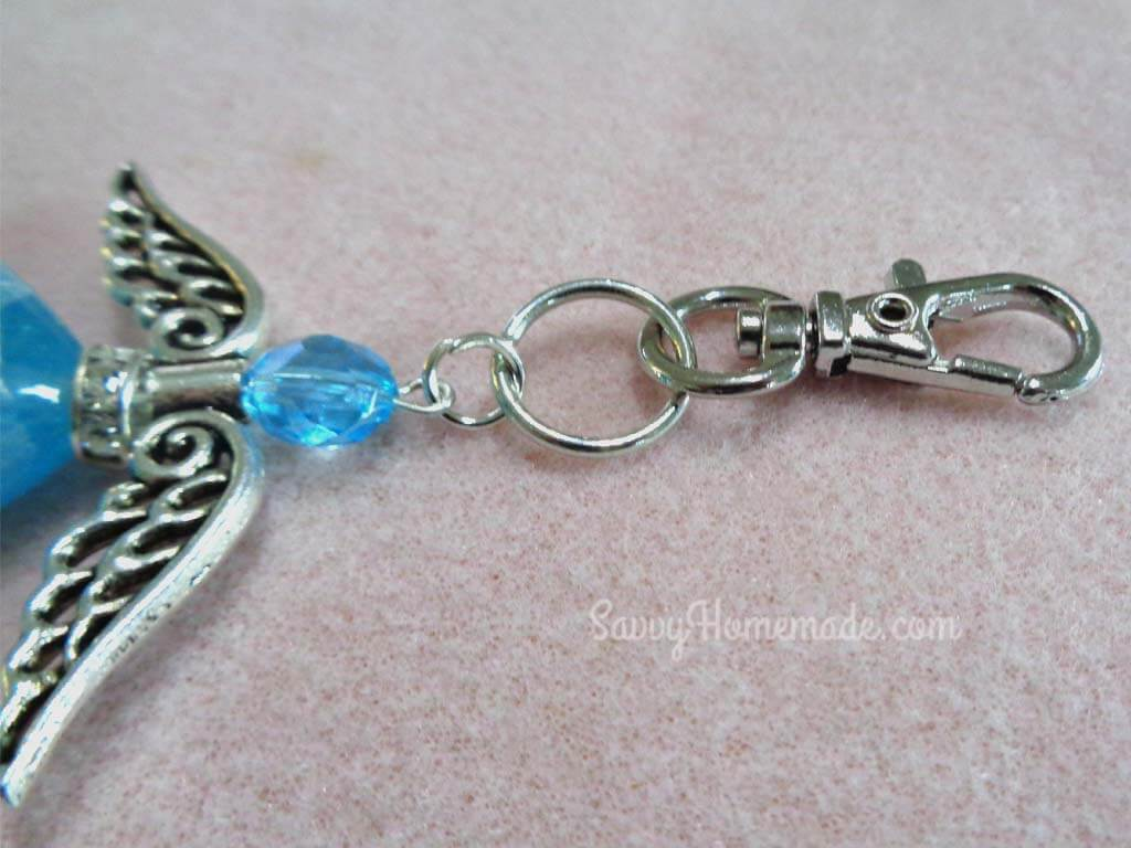 Attach the angle to the to the key chain with a strong jump ring