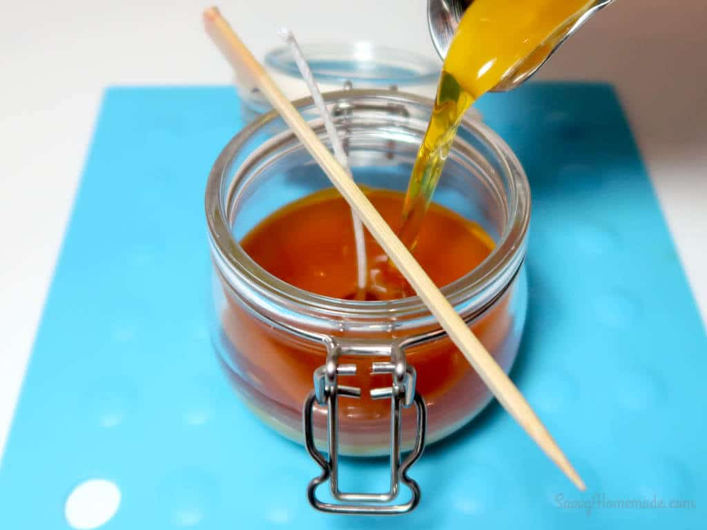 Slowly pour your wax into your jars.
