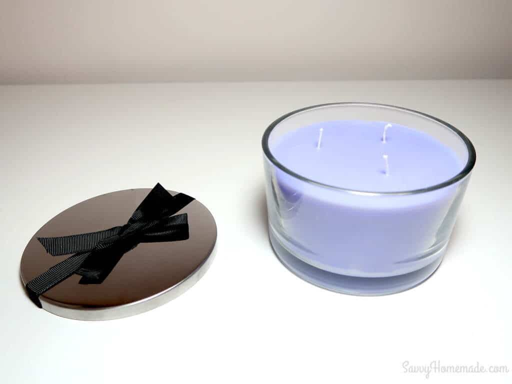 A DIY multi-wick candle jar with ribbon on the lid