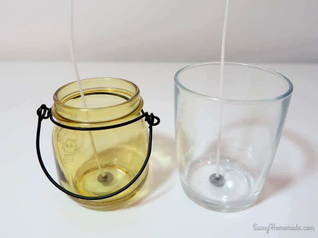 use a hot glue gun to fix the wick down