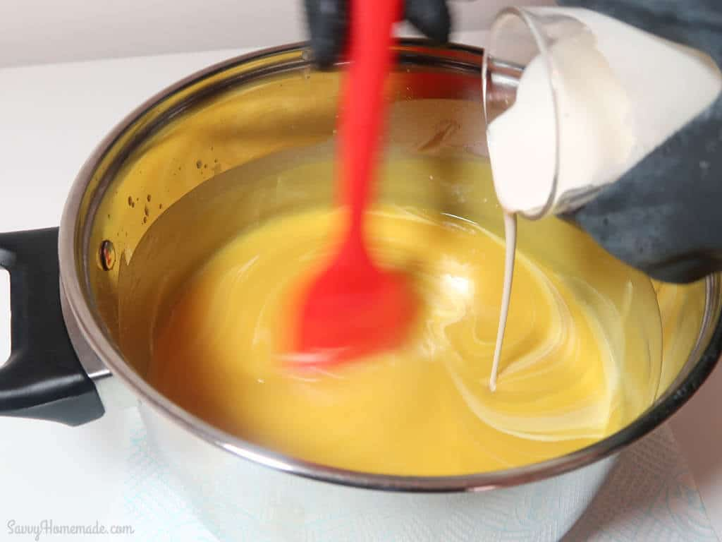 Now pour thetitanium dioxide mixture into the soap mixture and stir thoroughly.