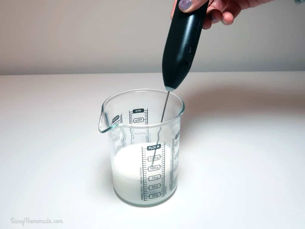 Using a mini stick blender, blend the mixture until thickened
