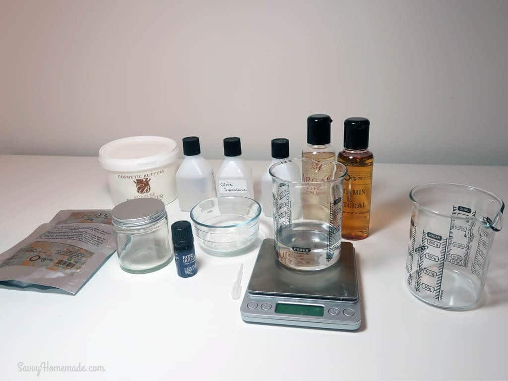 Ingredients for a luxurious natural face moisturizer with rose and argan oil