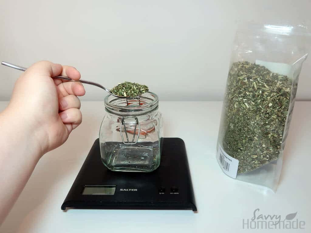 weighing dried herbs for a tincture recipe