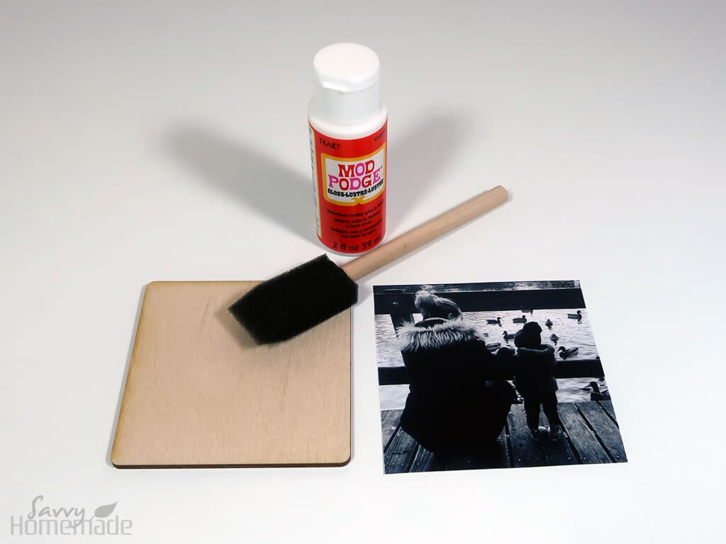 How to make coasters with pictures step 2: Using your mod podge, stick the photo to the wooden coaster square