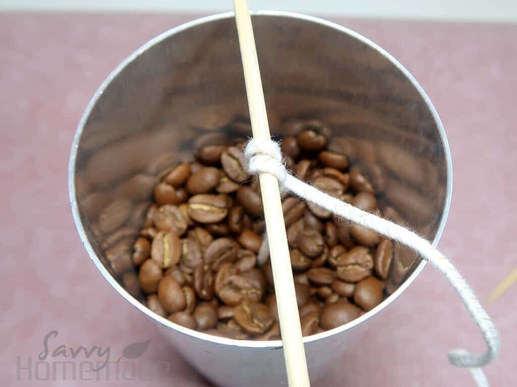 Add the coffee beans to the mold and remelt your wax