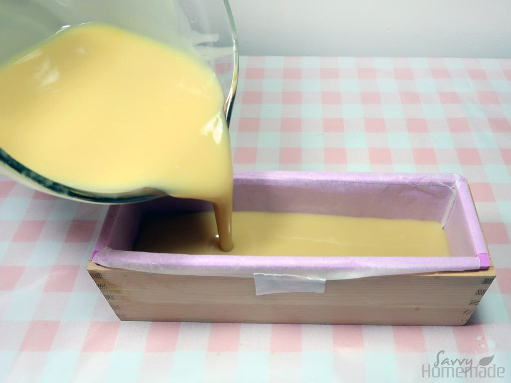 Working quickly but carefully so not to let the batter harden in the bowl, pour or spoon your batter into your soap mold