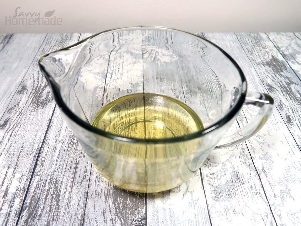Weigh out the coconut oil, olive oil and shea butter into a large, glass mixing bowl.