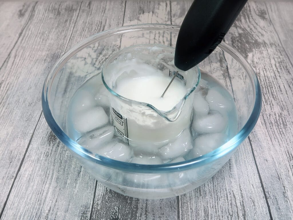 placing the container into a bowl of ice water whilst you stir it