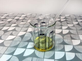 Put all of the carrier oil into your glass beaker