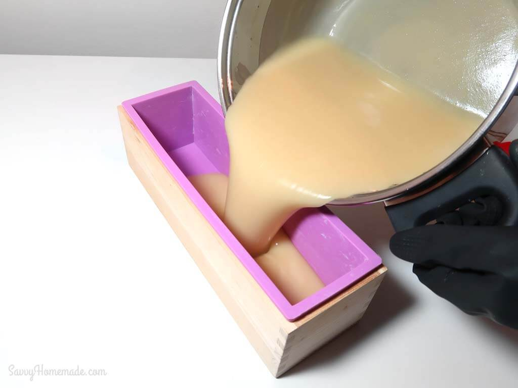 How to make soap: Once you have reached trace, pour the mixture into your chosen mold, working quickly but carefully.