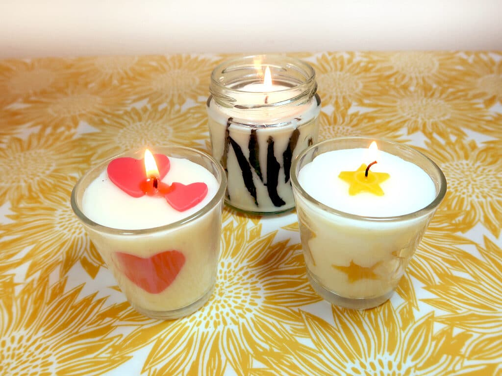 Homemade container candles with imbeds