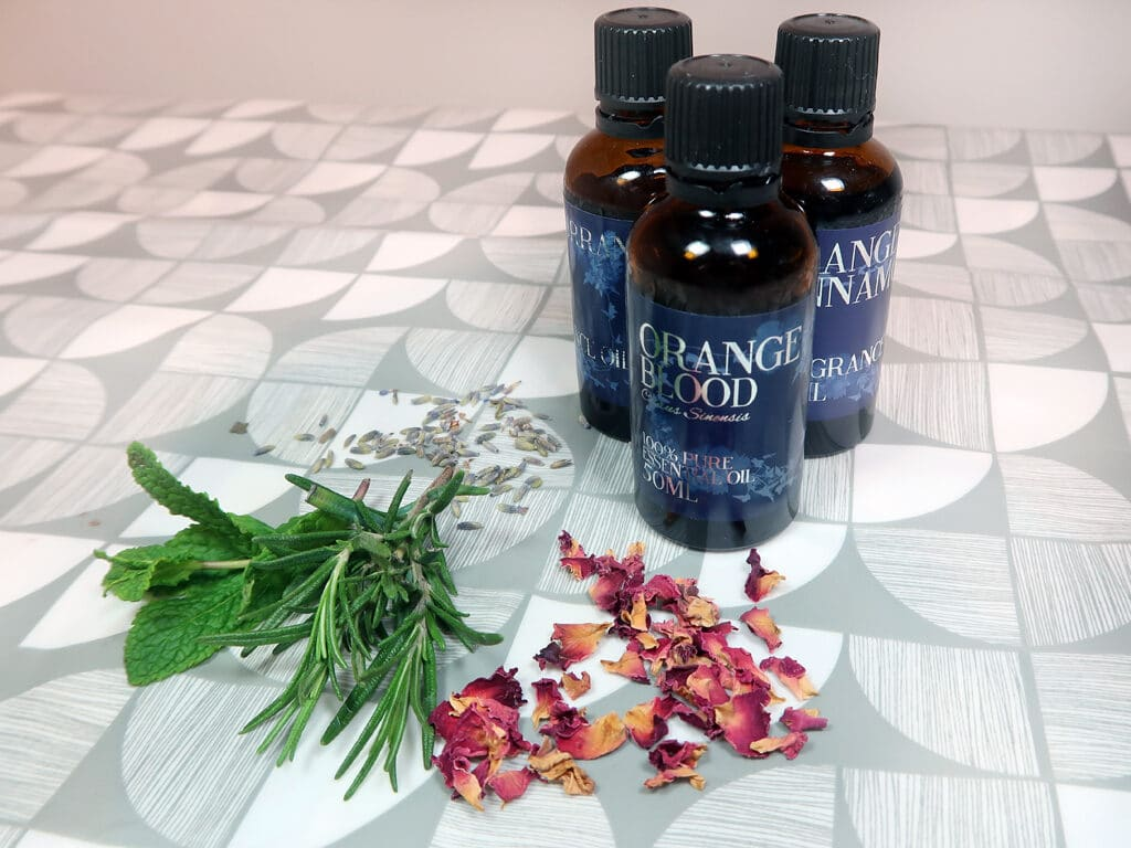 Bottles of essential oils, which are a wonderful addition to any dry shampoo recipe