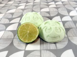 Two bath bombs bombs and half a lime
