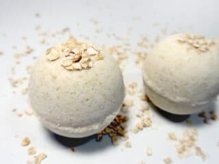 Two bath bombs with embedded oats