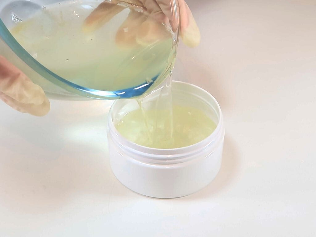 Enfleurage is poured into a plastic jar for storage