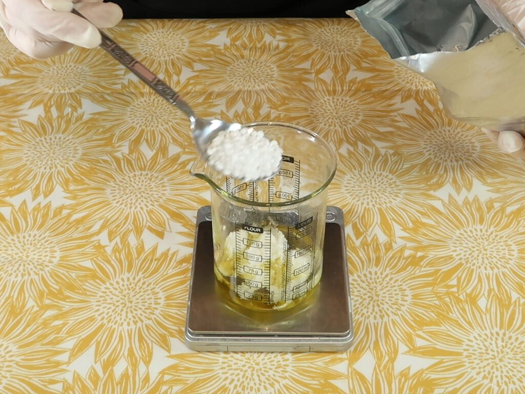 Oil phase ingredients being weighed into a pyrex beaker