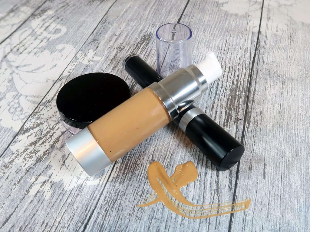 DIY Liquid foundation sitting with a blush sifter and mascara tube
